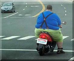 Fat man on bike